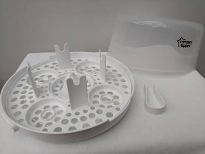 A microwave sterilizer, base, pincers and lid