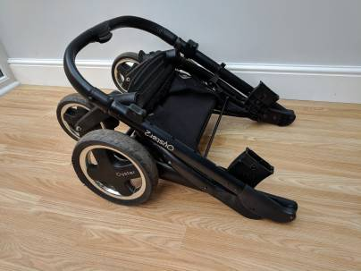 The frame of a drop fold stroller (without a carriage)
