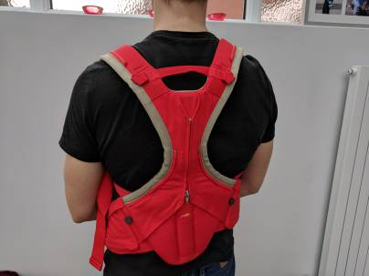 A baby carrier with joined shoulder straps and good back support (ideal for dads)