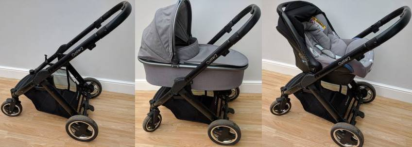 A stroller travel system frame, with bassinet carriage and car seat carriage fitted