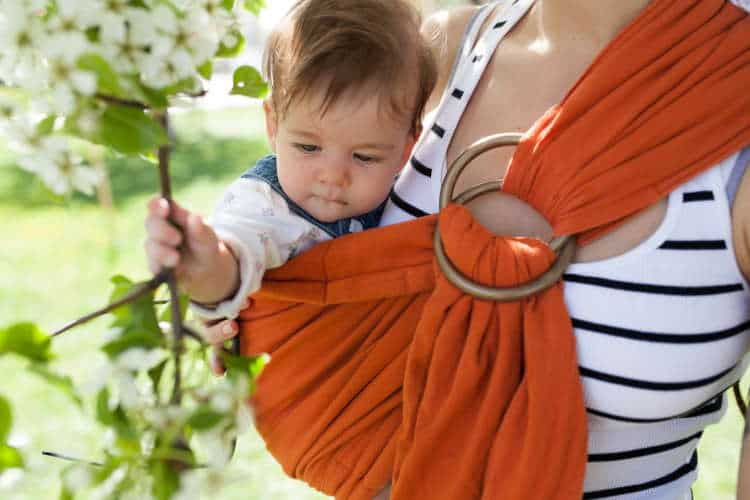 Closeup of toddler in a ring sling