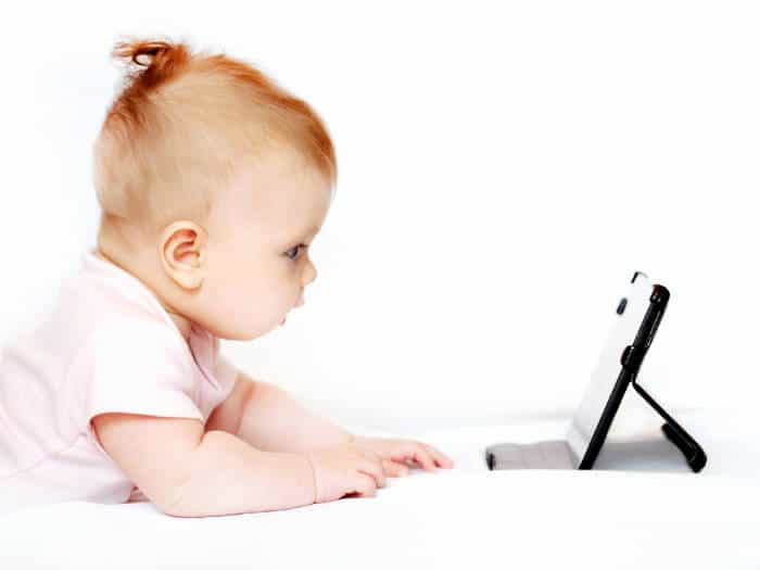 cute baby watching a tablet