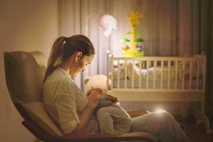 Nursing by nightlight in a nursery