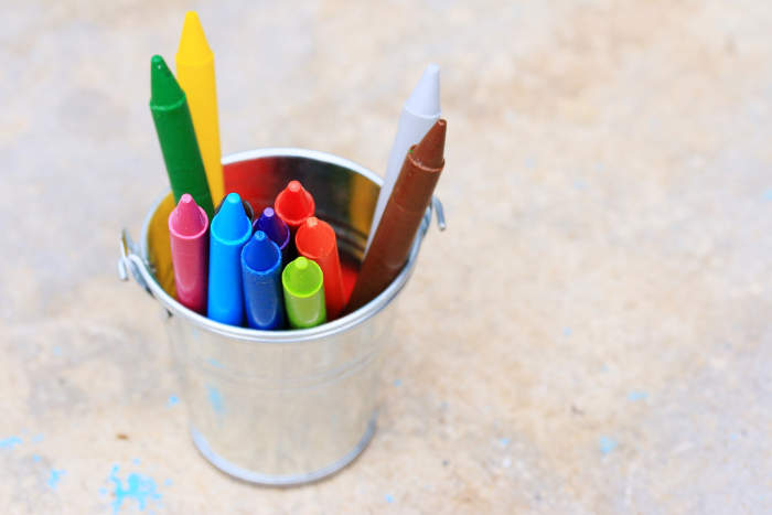 wax crayons in a metal pot