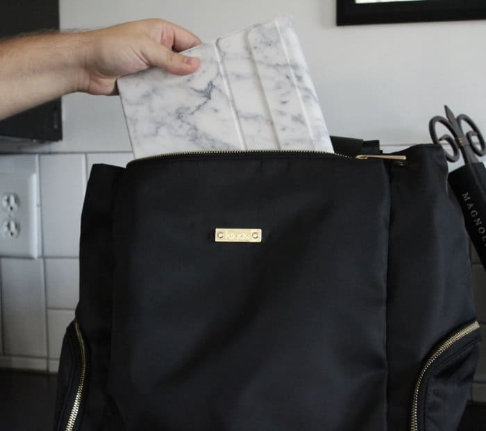 Putting a 10.2 inch iPad into the front pocket of the Anika bag