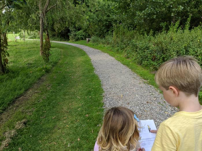 2 children reading a puzzle trail bookket