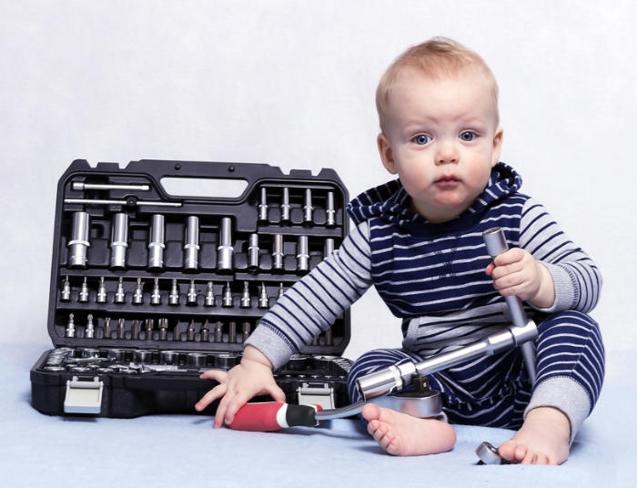 Toddler with adult tool set