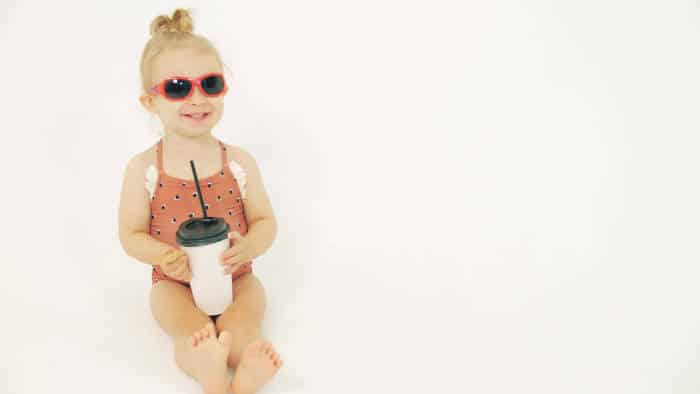 Baby girl with paper straw cup