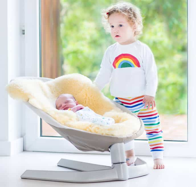 infant-in-baby-swing-with-sibling