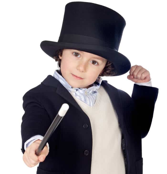 young boy with magicians hat and magic wand