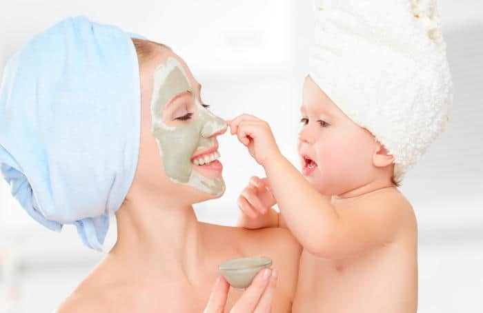 baby and mom with moisturizer